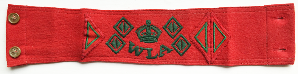 Red WLA Armband. Each half diamond denotes half a year of service. This Land Girl would have spent 5 years in the WLA. Source: Catherine Procter WLA Collection