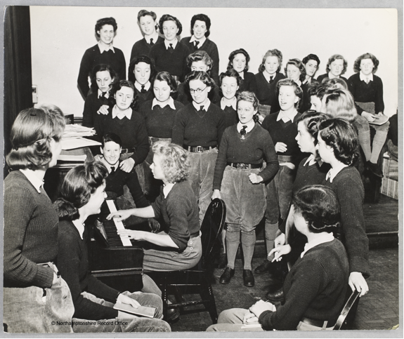 A get together after a day's training. Versatile Iris Joyce types, farms and also plays. Source: D8333, Northamptonshire Record Office. Courtesy of Dr David Wilson.