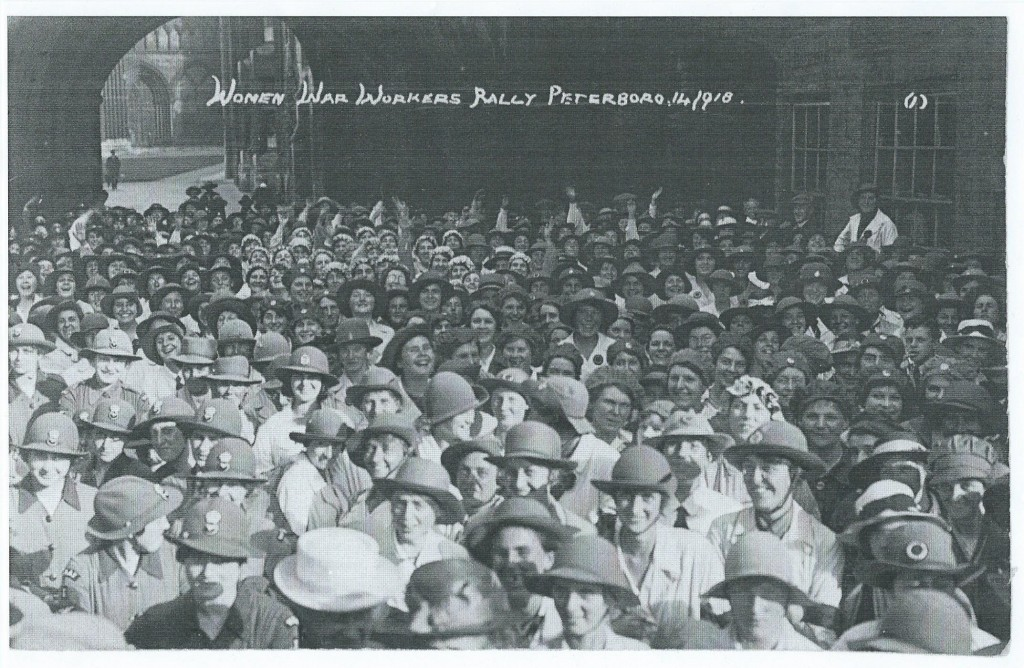 Land girls, foreground, face the camera, at Women War Workers Rally, Peterborough, 14 Sept 1918