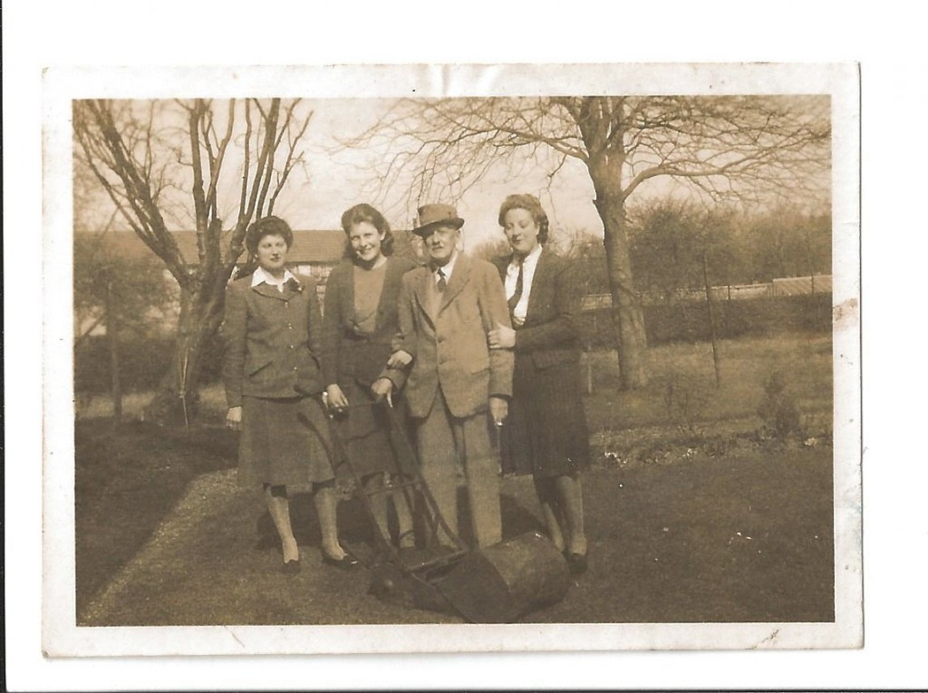 Joan and Geoff Shutte Archive Photo 8 Text on back of photo 'Theo, her Pap, Cousin Jane and myself. Taken while spending a lovely time at Keynsham. March '44'