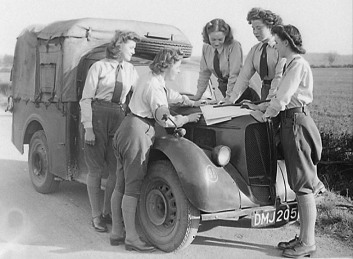 Women's Land Army land girls planning how to combat infestation of crops by colorado_beetles in bedfordshire, England, 1948