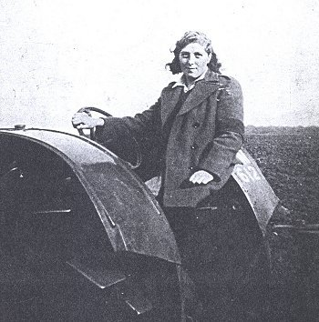Unknown Land Girl on a tractor.