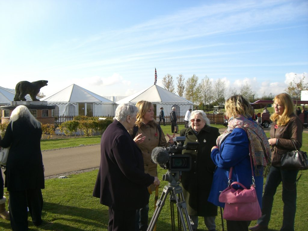 Mary Malpass being interviewed at the unveiling of the WLA and WTC memorial at the National Memorial Arboretum in October 2014
