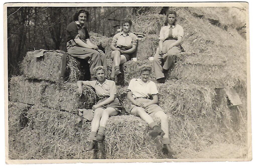 Joyce Charlton, Kitty Bland, Ena Smith, Sadie Brown, Joan Heaton working in the WLA in Buckinghamshire.