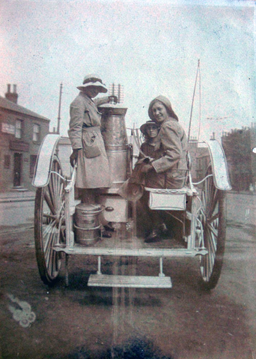Land Girls on back of milk float