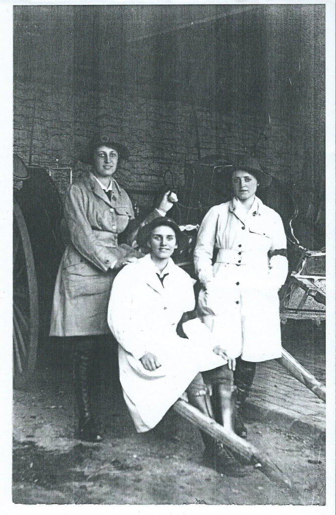 WW1 Three land girls in uniform at The Grange, Gunthorpe, Peterborough c1917