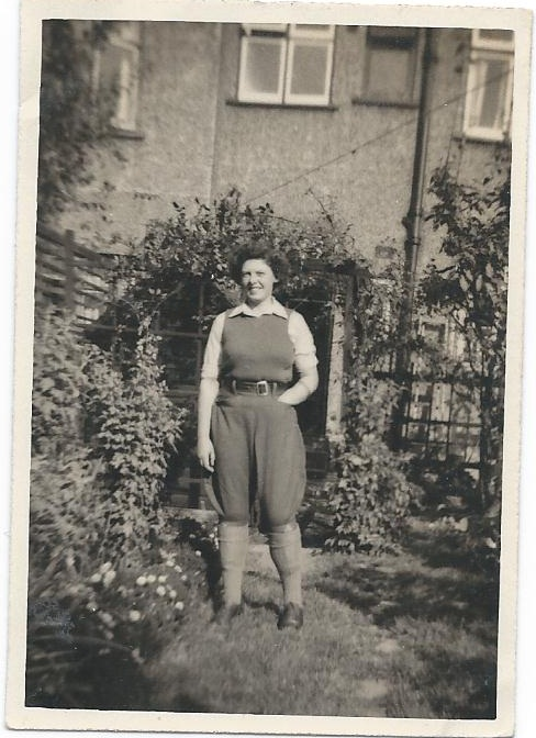 Betty in her Land Girl uniform in the garden of her family home in Peckham Rye in London, 1942 Source: Helen Van Dongen