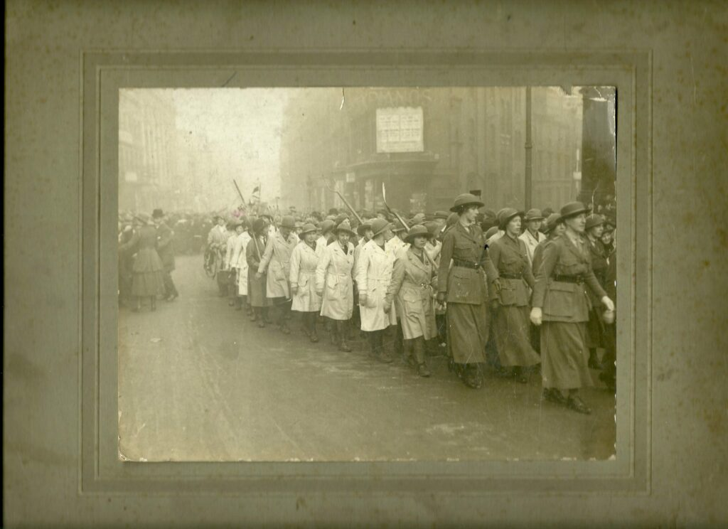 "Elise's caption for the photo: ""Woman's (sic) Land Army 1917. Rally, at Birmingham, going to see the Whip. Me!!! 5th Land Girl on the left."""