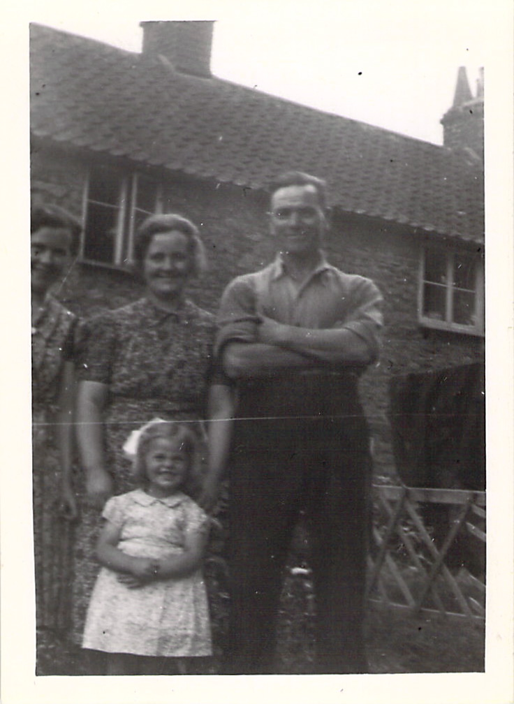 "Mrs Ashton, Mrs Cullimore, Mr Cullimore, and June outside ""The Ark"" at Wootton-u-Edge, 1943."