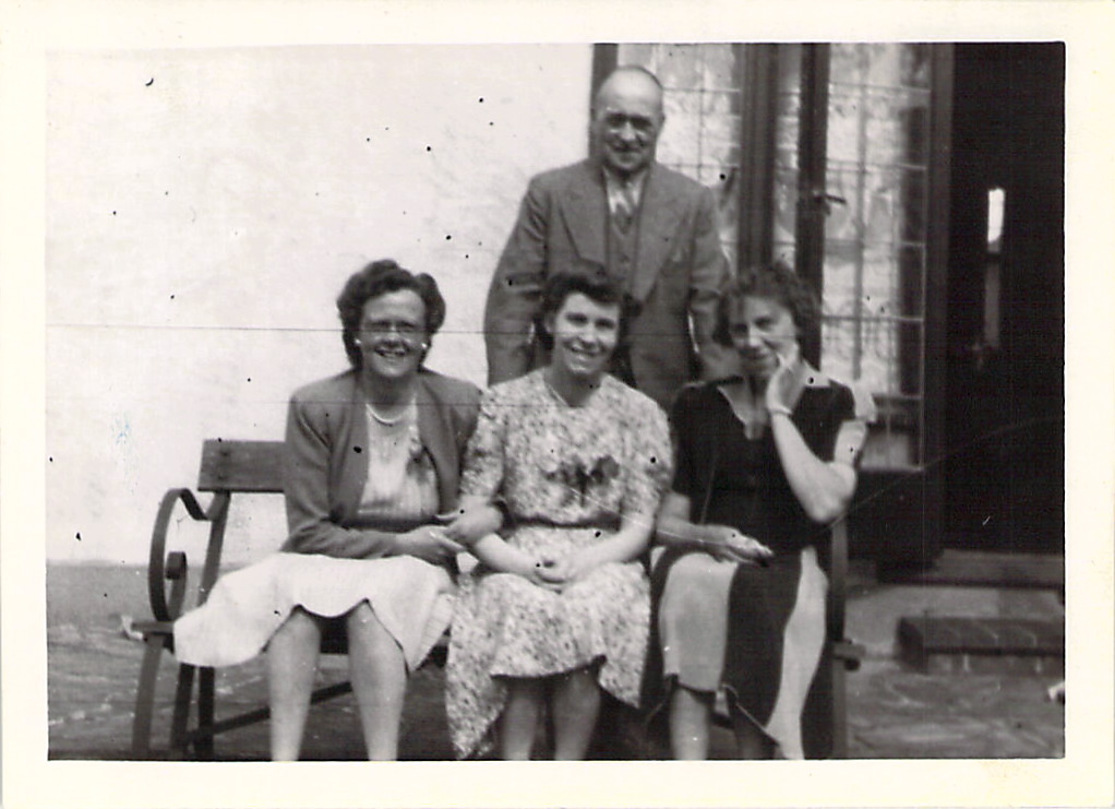 "Joy's father, Hilda, Marjorie, and Joy's mother outside ""The Homestead"", London, 1943."