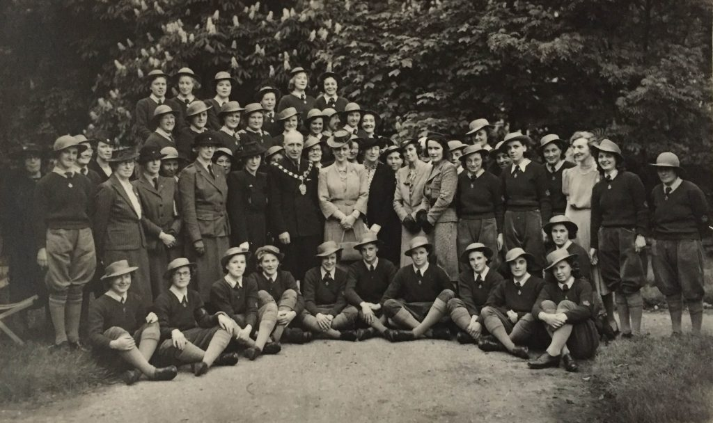 H.R.H The Duchess of Kent paid an informal visit to the new Y.W.C.A Land Army Hostel at Slough which was opened in response to the request of the Buckinghamshire Land Army Committee. The hostel used to be a boy's school, but began housing 50 girls working in market gardens. It had a large recreation room suitable for evening entertainments, an air raid shelter and a pleasant garden. Source: Catherine Procter WLA Collection.