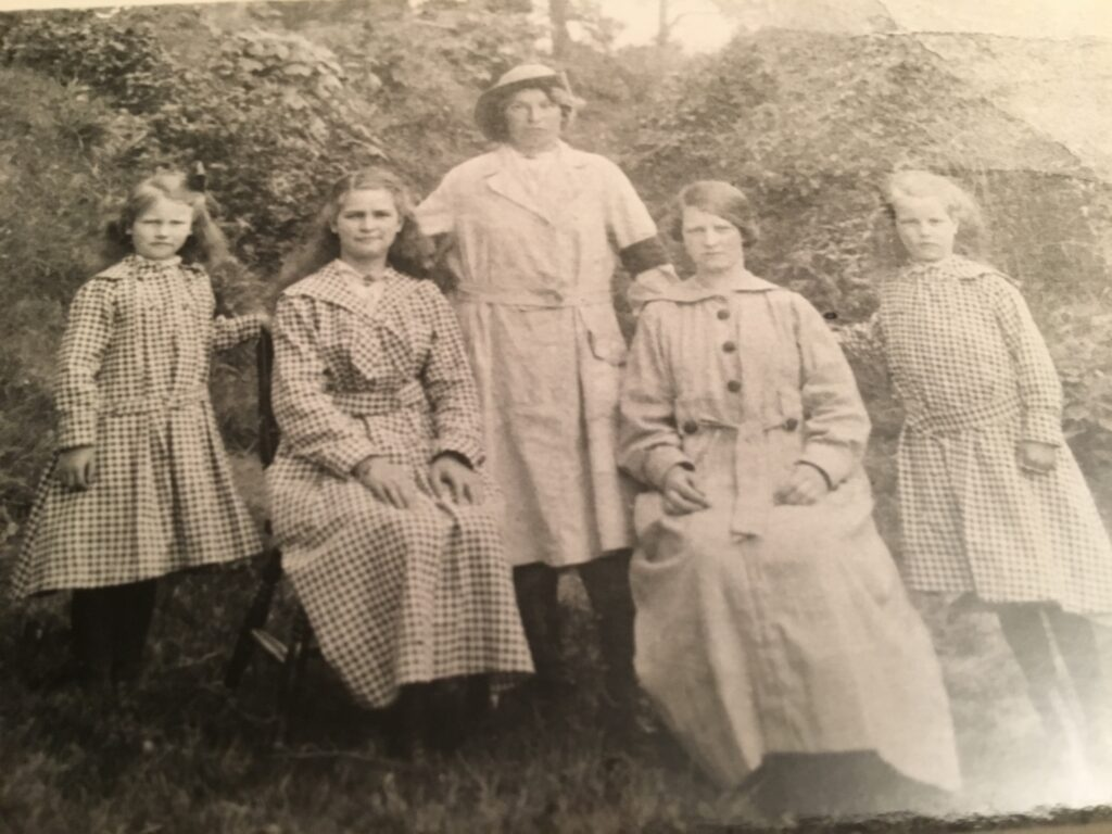 Catherine Jane Evans in her WLA uniform with her sisters.