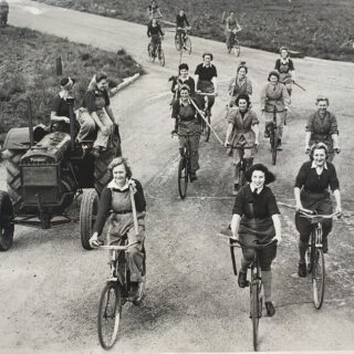 Land Girls on bikes: merrily we roll along