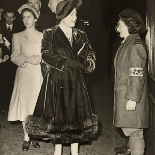 Queen talking to Land Girl at Harvest Festival in 1946