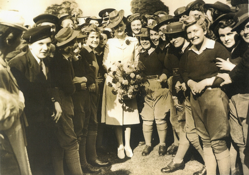 Princess Marina surrounded by Land Girls.
