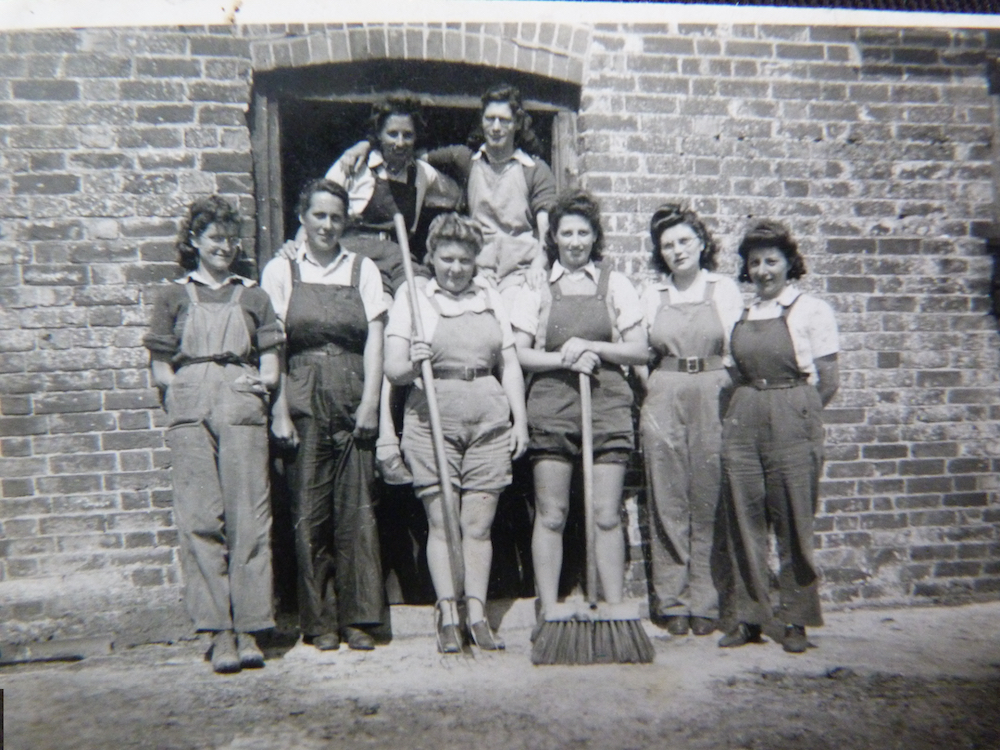 Betty Parker with her colleague. Betty is at the front, third from the left, holding a pitch-fork! c.1944