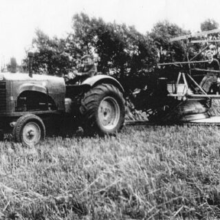 Emma Chapman working reaper-binder at Walnut Farm, Newport Pagnell, August 1941